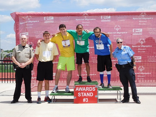 Happy winners on award stand at Special Olympics Missouri