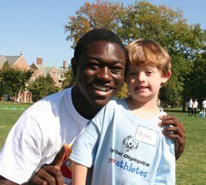 Volunteer hugging Special Olympics Missouri participant
