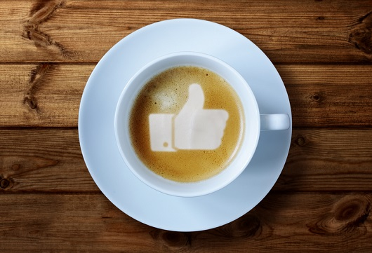 Facebook thumbs up in a cup of coffee