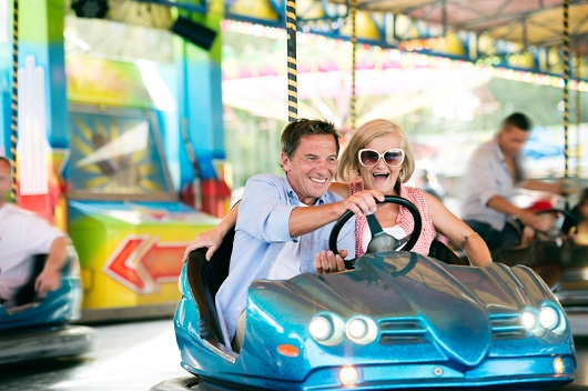 Older couple having a good time in a bumper car