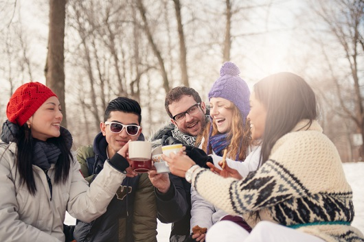 Group of millennials enjoying a hot beverage