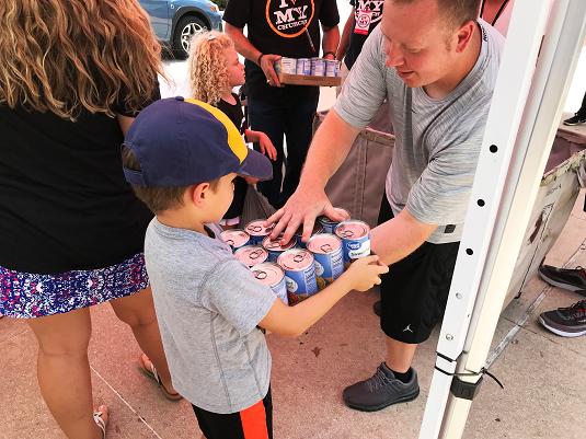St. Matthews House Volunteers Giving Food